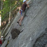 Rick Laidlaw moving up and over Slabs Overhang (5.7), at Pawtuckaway State Park.