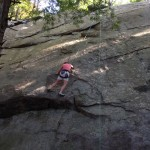 Laura Alexander performing a variation between The Dike (5.8) and Slabs Overhang (5.7), at Pawtuckaway State Park, NH.